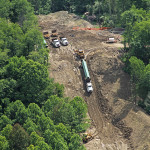 Pipe truck on steep hillside, cabled to dozer. (Stonewall Gathering Pipeline, West Virginia)