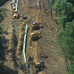 Trench excavation and placement of pipe.